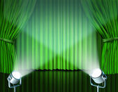 Spotlights on green velvet cinema curtains — Stock Photo