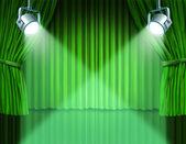 Schijnwerpers op groene fluweel bioscoop gordijnen — Stockfoto