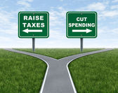 Raising taxes or cutting spending — 图库照片