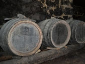 Barrels in a wine-cellar — Stock Photo