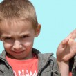 Little boy showing a gesture — Stock Photo #7823371