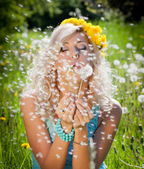 Young blonde woman in the park — Stock Photo