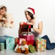 Two smiling christmas girls unpacking gifts — Stock Photo #7539165