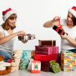 Two smiling christmas girls unpacking gifts — Stock Photo