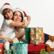 Two smiling christmas girls wearing Santa hat. — Stock Photo