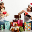Two smiling christmas girls unpacking gifts — Stock Photo #7539184