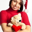 Portrait of beautiful sexy girl in Santa hat holding bear — Stock Photo
