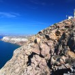 Santorini lighthouse and caldera view - Stock Photo