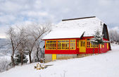 Rural house in winter landscape — Stock Photo