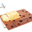 Royalty-Free Stock Photo: Wooden cutting board with cheese slices