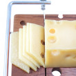 Wooden cutting board with cheese slices — Zdjęcie stockowe #7340022
