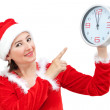 Beautiful girl holding Christmas watch. — Stock Photo