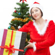 Royalty-Free Stock Photo: Girl in Christmas costumes with gifts.