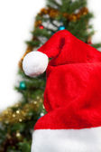 Santa hats on the background of trees — Stock Photo