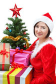 A girl in costume with gifts. — Stock Photo