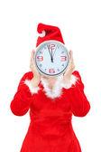 Dívka drží vánoční hodin. — Stock fotografie