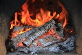 Fireplace with burning wood and flames — Stock Photo