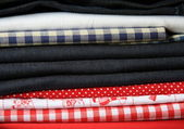 Stack of fabric with linen and jeans — Stock Photo