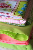 Stack of linen in green and pink — Stock Photo