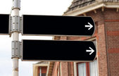 Blank signpost in black — Stock Photo