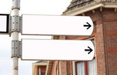 Blank double signpost in white — Stock Photo