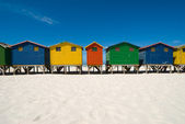 Multi colored beach huts — Stock Photo