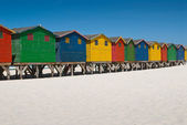 Line of colorful beach huts — Stock Photo