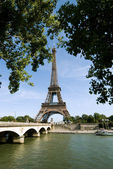 Eiffel tower at river seine — Stock Photo