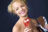 Beauty girl with candy and chocolate — Stock Photo