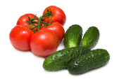 Ripe tomatoes and cucumbers — Stock Photo