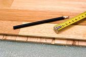 Installing wooden floor — Stock Photo