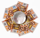 Glass globe with a focus on Europe and Africa on a Euro bills on — Stock Photo