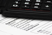 Calculator on Bank Statement — Stock Photo