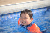 Child in the swimming pool — Stock Photo