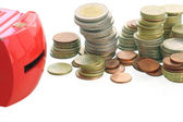 Many coins with money bank close up — Stockfoto