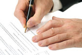 Contract signing hand and pen — Stock Photo
