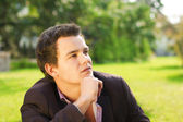 Thinking young man — Stock Photo