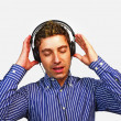 Young man with headphones singing — Stock Photo