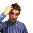 Attractive guy scratching his head — Stock Photo