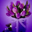 Stock Photo: Tulips on background