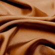 Brown smooth textile as abstract background — Stock Photo #7787825