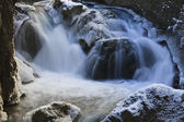 A small waterfall in winter — Stock fotografie