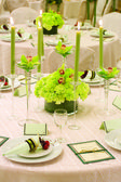 Ready for an indoor wedding reception with round tables — Stock Photo