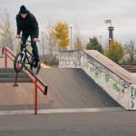 Постер, плакат: Biker doing crank slide grind trick