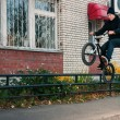 Stock Photo: Biker doing icepick grind trick