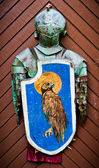 Knights armour hanging on the wooden door — Stock Photo
