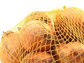 Onion in net — Stock Photo