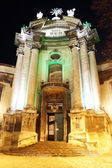Illuminated facade of Dominican church in historical Lviv — Stock Photo