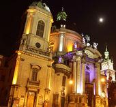 Illuminated facade of Dominican church in historical Lviv — Stock Photo