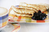 Pancakes with bilberry jam and coffee — Stock Photo